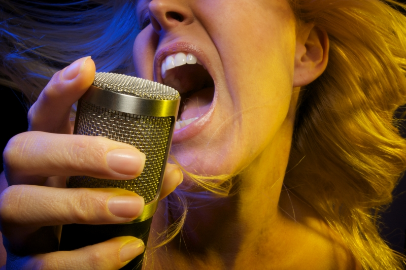 310159-woman-sings-with-passion
